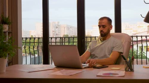 Successful CEO of Start Up Company Typing on the Laptop