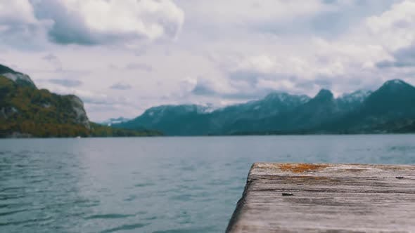 Thumbnail for Wooden Pier on the Background of a Mountain Lake and Snowy Alps, Austria, Wolfgangsee Lake