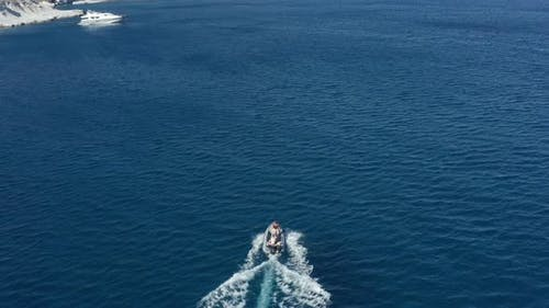 Aerial of Motorboat on Blue Ocean Exploring the Unknown