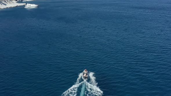Thumbnail for Aerial of Motorboat on Blue Ocean Exploring the Unknown