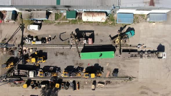 Thumbnail for Top View of Cranes Moving Shipping Container on Industrial Site