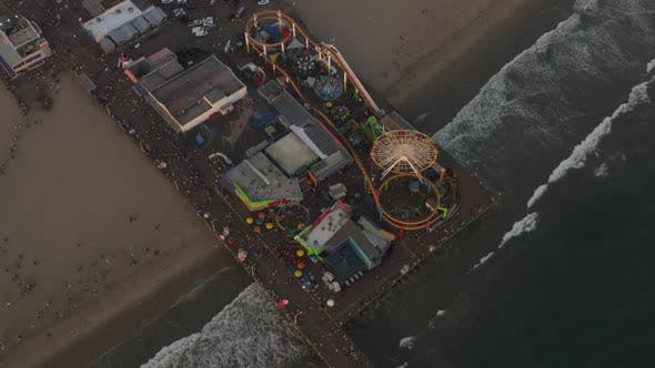 Thumbnail for AERIAL: Circling Santa Monica Pier, Los Angeles From Above at Beautiful Sunset with Tourists