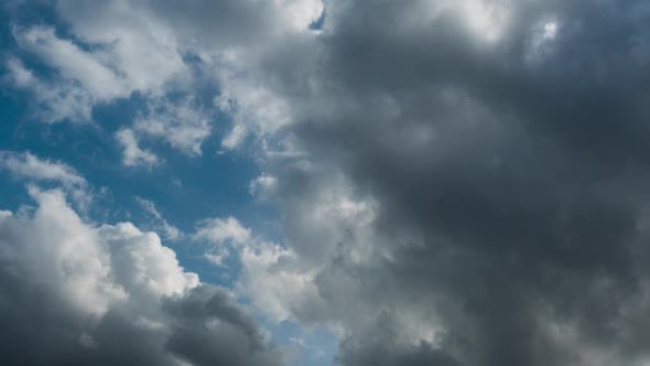 Thumbnail for Cumulus Clouds Rolling over Blue Sky