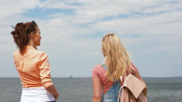 Cover Image for Teenage Girls or Friends Walking at Seaside