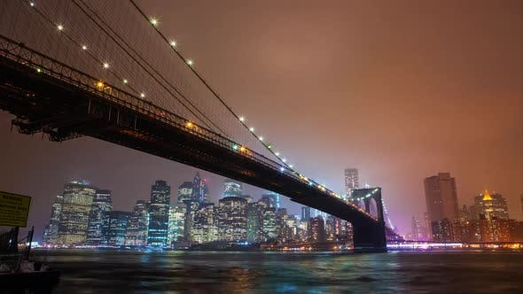 Thumbnail for Time lapse of the Brooklyn Bridge overlooking the East River to Manhattan at night