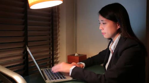Businesswoman working at night