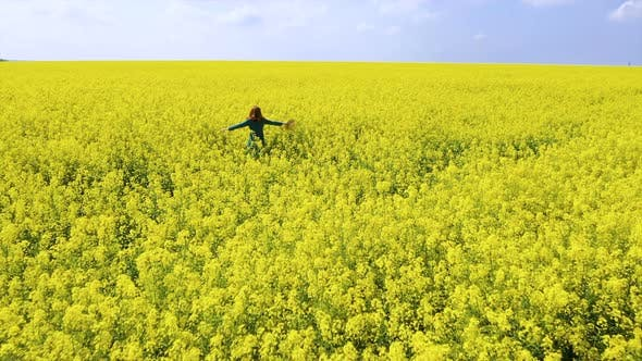 Thumbnail for Happy Girl Enjoying At The Rapeseed Field