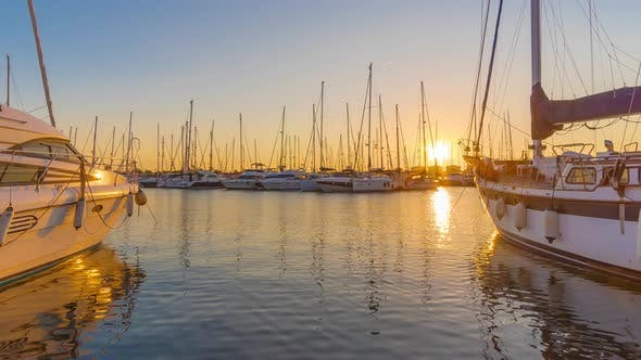 Thumbnail for Time Lapse. Sunset Scene at Marina with Yachts Tied To the Docks, Sun and Sky Beautiful Color