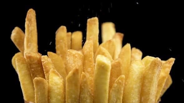 Adding Salt On Crispy French Fries In Slow Motion
