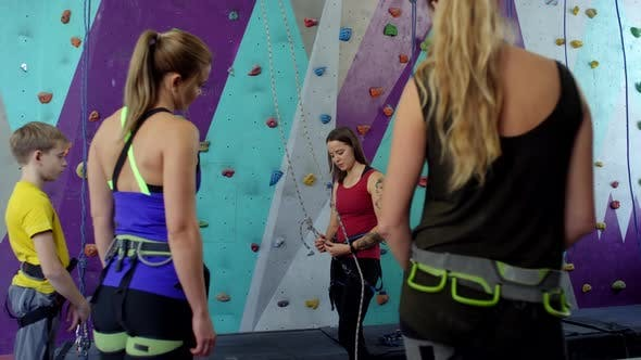 Thumbnail for Group of Beginners Listening to Safety Instructions at Climbing Gym