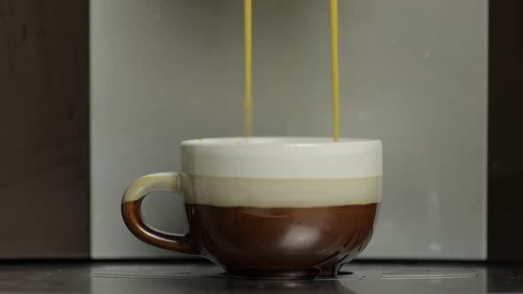 Thumbnail for Espresso Shot Pouring Out From Coffee Machine in Small White and Brown Cup. Close Up Footage