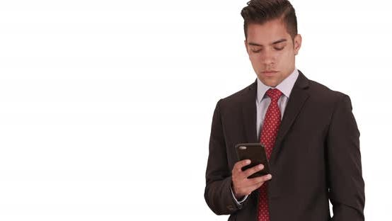 Thumbnail for Businessman sms messaging or using social media on cell phone with white background