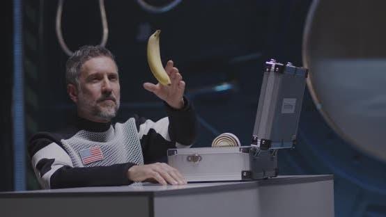 Thumbnail for Astronaut Pushing Banana in Zero Gravity