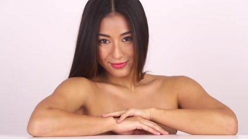 Topless Chinese woman looking at camera