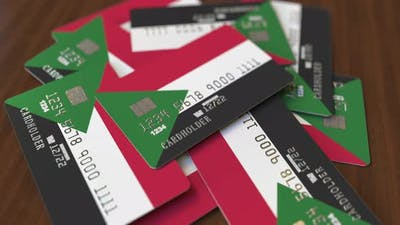 Pile of Credit Cards with Flag of Sudan