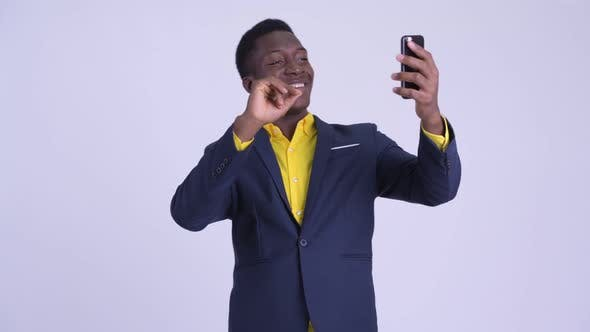 Young Happy African Businessman Video Calling with Phone