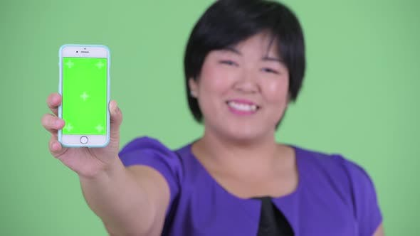 Thumbnail for Face of Happy Young Overweight Asian Woman Showing Phone