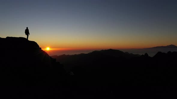Thumbnail for Silhouette Of Man Watching Mountain Sunset