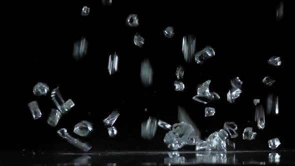 Thumbnail for Crystals Fall on a Black Background. Slow Motion