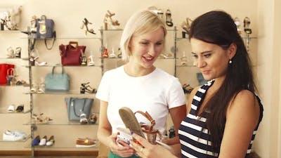 Women Choosing Shoes in Shoe Shop