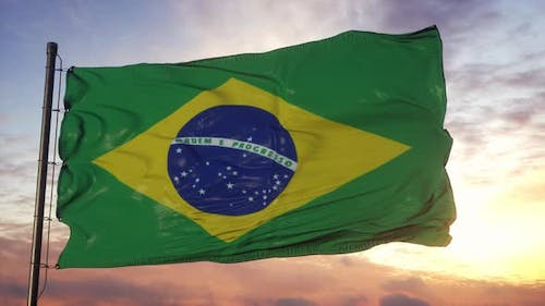 Flag of Brazil Waving in the Wind Against Deep Beautiful Sky at Sunset