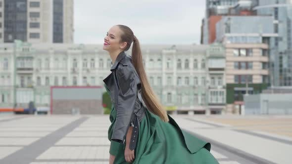 Thumbnail for Beautiful Gorgeous Girl in a Stunning Evening Green Dress Cheerful and Happy Walking on Empty City