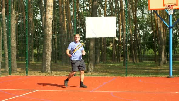 Thumbnail for Male Tennis Player Hitting Backhand in Tennis Game