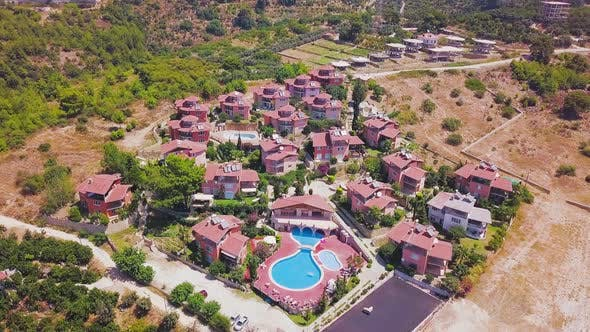 Top view of resort cottages and swimming pool