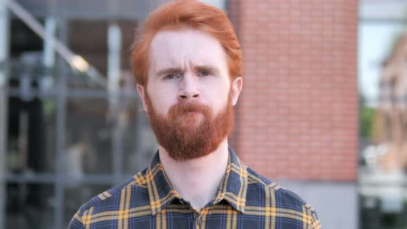 Thumbnail for Outdoor Portrait of Upset Redhead Beard Young Man