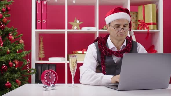 Thumbnail for Corporate Employee Works Hard on Annual Report in Office Seconds Before New Year