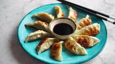 Traditional Asian Dumplings Gyozas on Turqoise Ceramic Plate