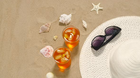 Thumbnail for Cocktails, Sun Hat and Sunglasses on Beach Sand