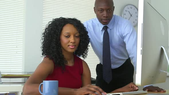 Thumbnail for Black business colleagues using computer together