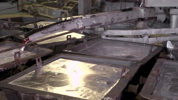 Thumbnail for Close-up, the Hot Metal Is Poured From the Furnaces Special Baths. Aluminum, the Material That Is