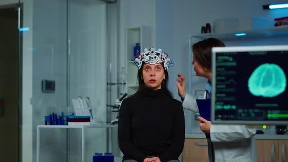 Neurological Doctor Cheking Eeg Headset Explaining Treatment