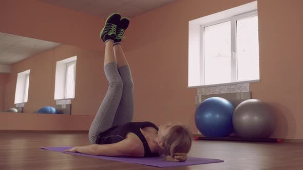 Thumbnail for Beautiful Female Intense Physical Exercise Abdominal Muscles