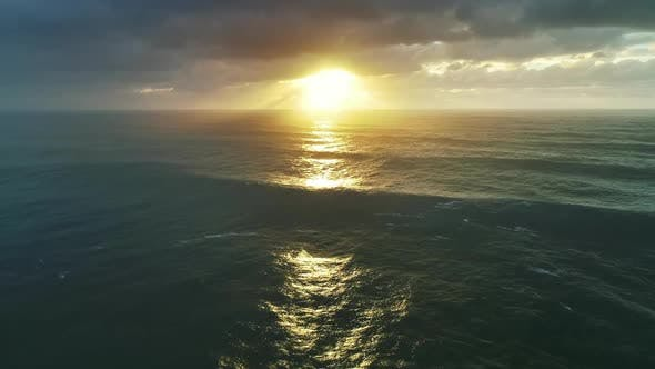 Thumbnail for Aerial View on Big Waves and Dramatic Sunset Sky