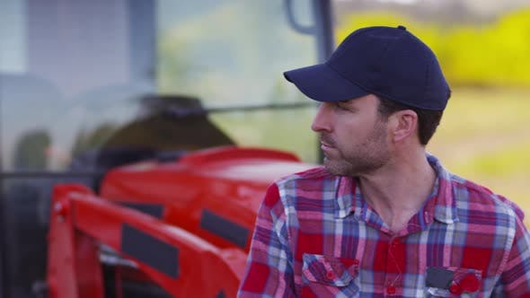 Portrait of farmer sitting on tractor