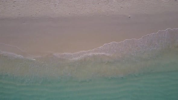 Drone aerial landscape of seashore beach by blue lagoon and sand background