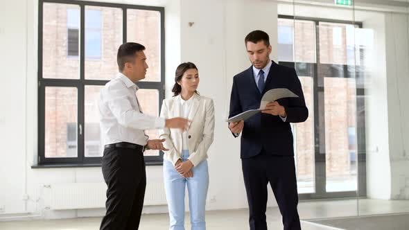 Realtor with Folder Showing Documents To Customers