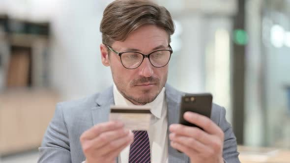 Thumbnail for Portrait of Online Payment Failure on Smartphone By Businessman