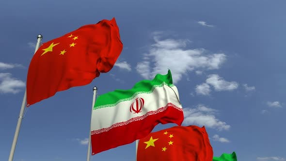 Waving Flags of Iran and China on Sky Background