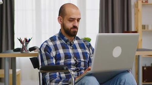 Handicapped Freelancer in Living Room
