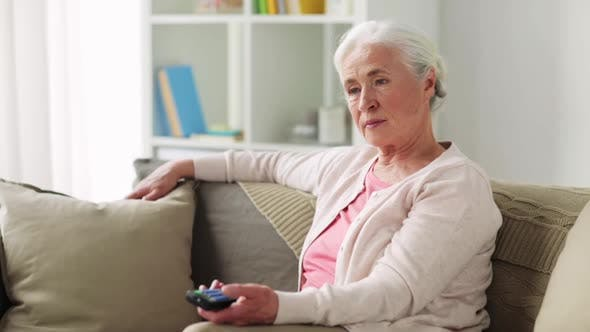 Thumbnail for Senior Woman with Remote Watching Tv at Home
