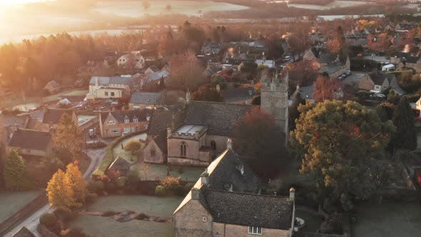 Aerial drone video of Typical English village and beautiful British countryside scenery in The Cots