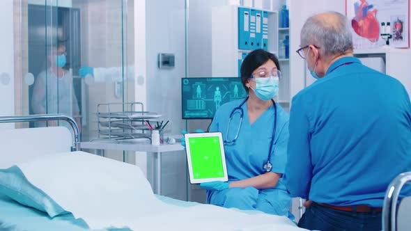 Thumbnail for Patient Looking at Green Screen Digital Tablet