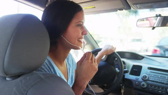 Thumbnail for Hispanic woman driver talking with earphones