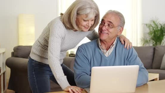 Thumbnail for Mature couple using laptop computer together