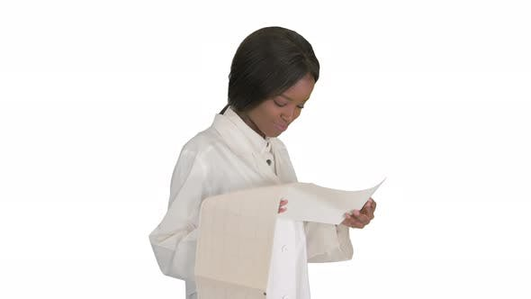 Smiling African American Female Doctor Reading Cardiogram on White Background