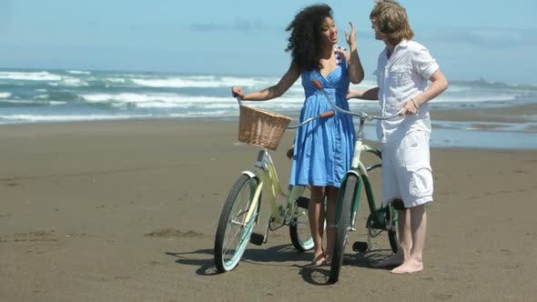Thumbnail for Portrait of couple at beach with bicycles